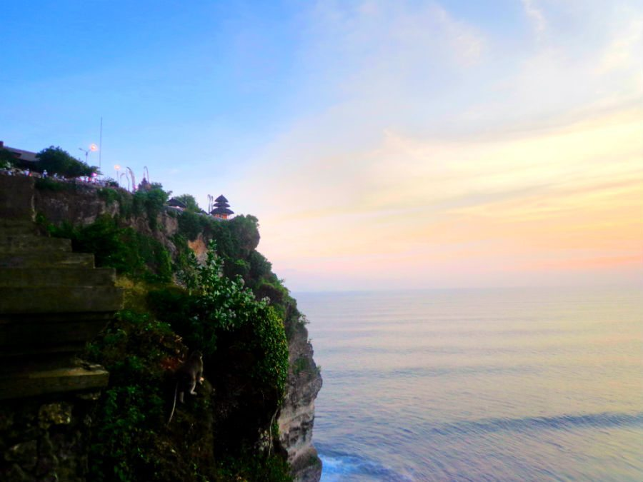 Image of crashing waves and sunset at Ulu Watu temple, Bali